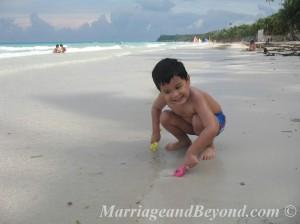 jed on white beach sand