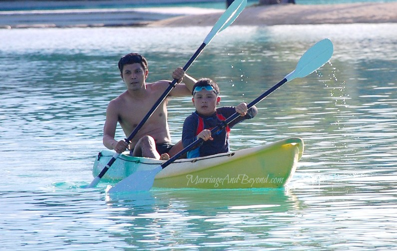 kayaking father and son
