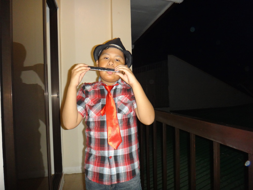 Boy playing a harmonica