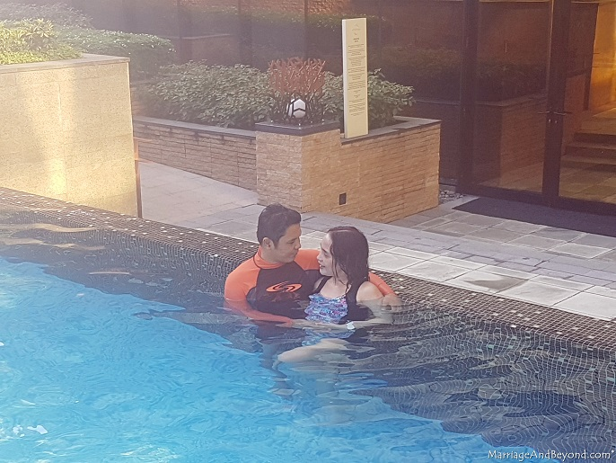honeymooners at the pool at hyatt cod