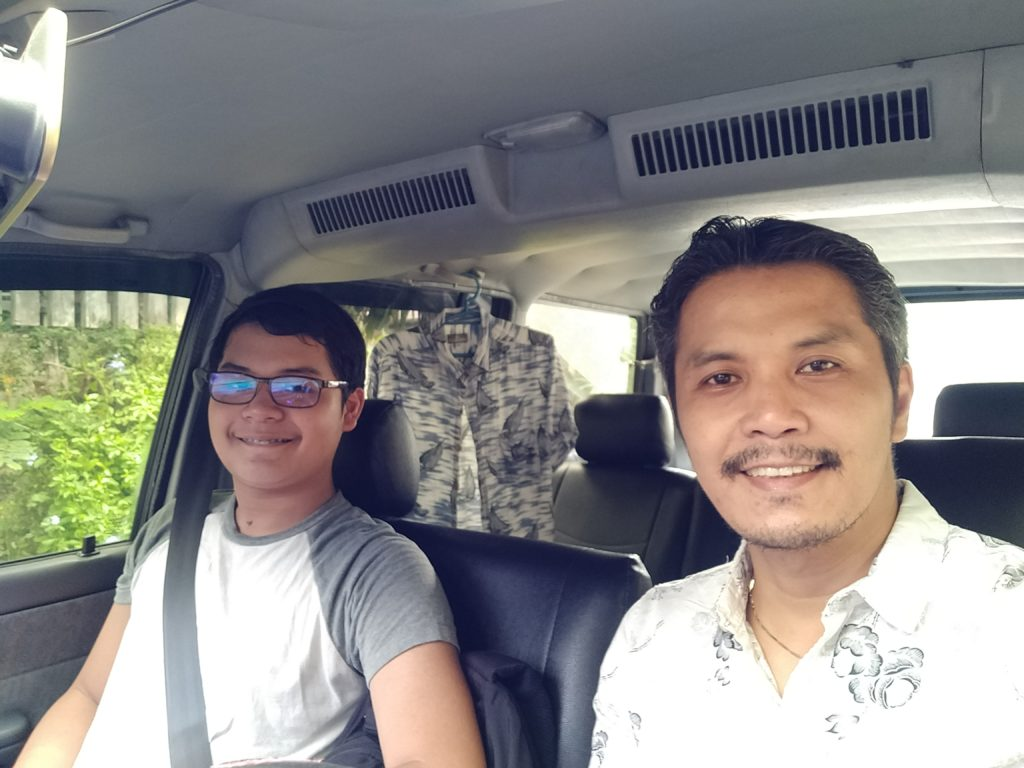 Father and son driving to the Casting Call and Workshop Modello FIlipinas Cafe Lupe